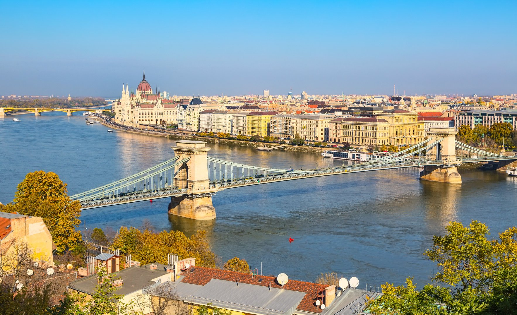 skyline panorama of Budapest, Hungary with Danube, chain bridge, ships and houses