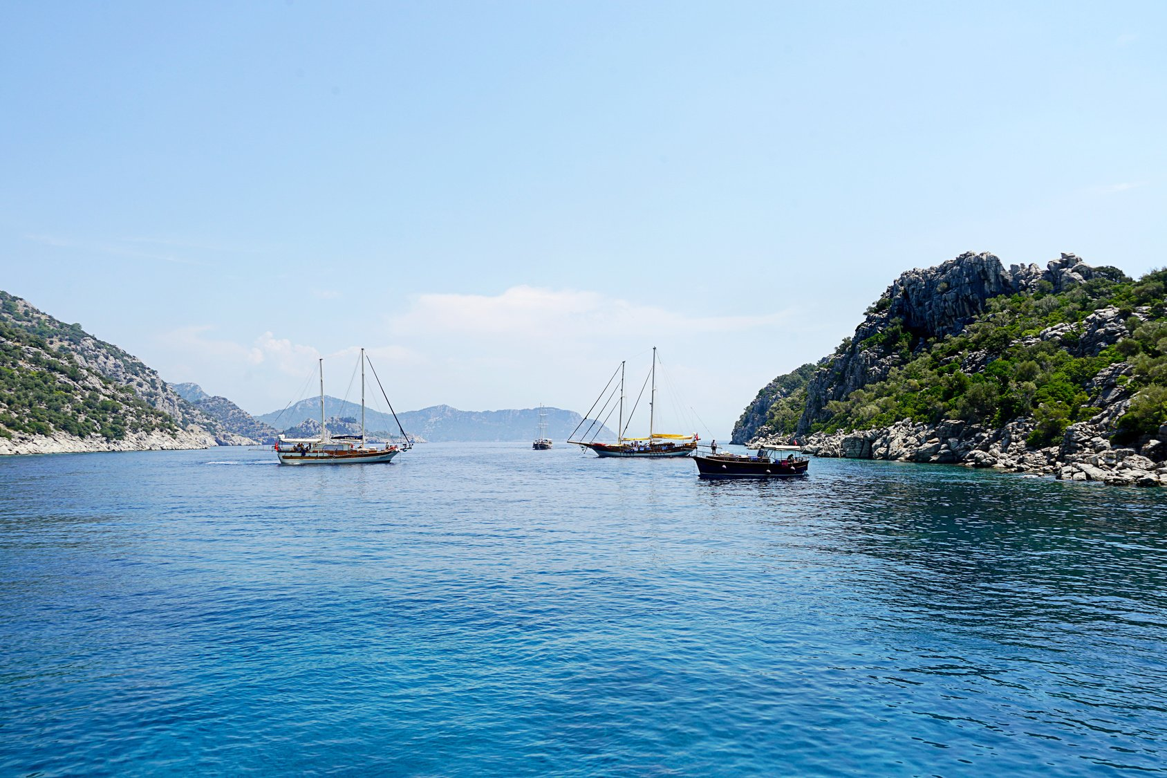 Islands, Blue sea and blue tour boats yachting